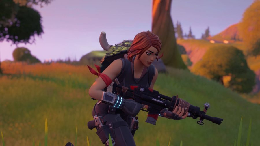 The player is wearing a hunter's cloak on her back, one of the crafting items in Fortnite