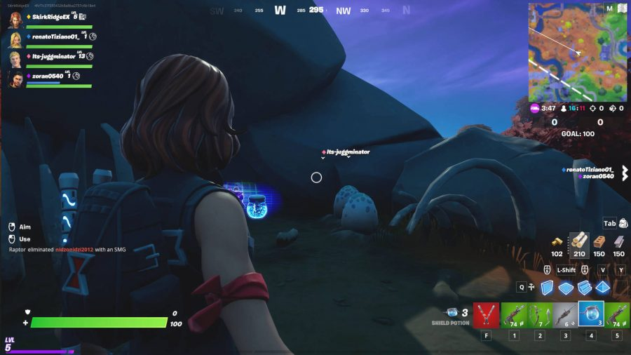 The player is looking at some eggs hidden behind a rock in Fortnite, just southeast of the Spire.